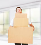 Young man carrying carton boxes Royalty Free Stock Photo