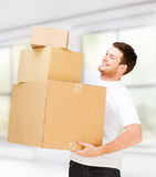 Young man carrying carton boxes Royalty Free Stock Photography