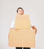 Young man carrying carton boxes Stock Images