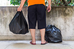 Young man carrying garbage bag Royalty Free Stock Photography