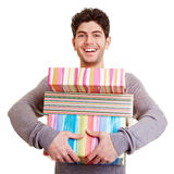 Young man carrying gifts Stock Photos
