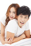Young Man carrying girlfriend in bed Royalty Free Stock Images