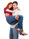 Young man carrying girlfriend in his arms Royalty Free Stock Images