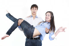 Young man carrying girlfriend in his arms Royalty Free Stock Image