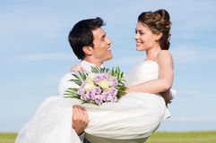 Young Man Carrying Her Wife Royalty Free Stock Images