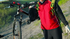 Young man carrying his bicycle stock footage