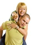 Young man carrying his cute girl on back Stock Photography