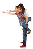Young man carrying his cute girl on back Royalty Free Stock Images