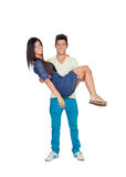 Young man carrying his girlfriend in his arms Royalty Free Stock Image