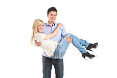 Young man carrying his girlfriend. Young men carrying his girlfriend isolated on white background Royalty Free Stock Image