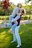Young man carrying his pretty girlfriend. Young man is carrying his pretty girlfriend Royalty Free Stock Photos
