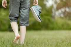 Young man carrying his shoes Royalty Free Stock Photo