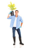 Young man carrying plant Royalty Free Stock Photography