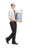 Young man carrying a recycle bin Royalty Free Stock Photos
