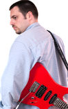 Young man Carrying a red guitar Royalty Free Stock Photography