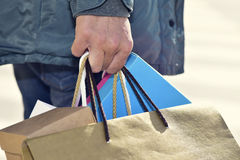 Young man carrying some shopping bags Stock Images
