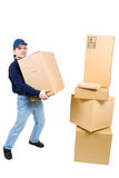 Young man carryinng a cardboard box Stock Photos