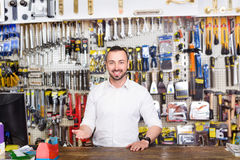 Young man cashier at pay desk Royalty Free Stock Image