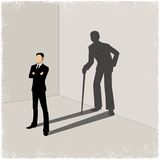 Young man casting shadow of old man Stock Photo