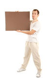 Young man in casual clothes with empty board Royalty Free Stock Photography
