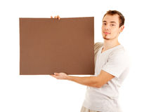 Young man in casual clothes with empty board Royalty Free Stock Photos
