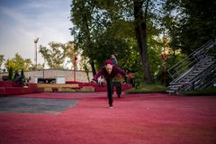 A young man in casual. freerun in urban city doing somersault roll while running. Young man in casual. freerun in urban city doing somersault roll while running stock image
