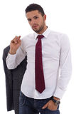 Young man in casual office attire. Young caucasian man with jacket and jeans on white background Royalty Free Stock Images