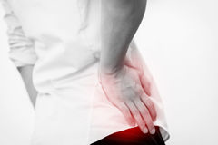 Young man in casual office shirt having hip pain. (black and white Stock Photography