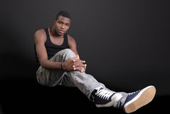 Young man. In casual seated pose, a full length portrait Royalty Free Stock Photography