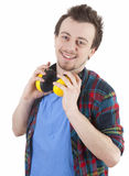 Young man in casual shirt with safety earphones Royalty Free Stock Photo