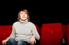 Man in the cinema. Young man in casual sitting in the cinema and watching a movie Stock Image