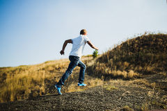 Young man in casual wear running Stock Images