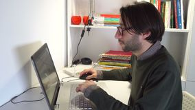 Young man In casual wear working in office on desk
