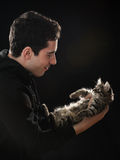 Young man with cat royalty free stock photos