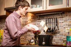 Young man catching fresh popped out toasts on white plate Royalty Free Stock Images