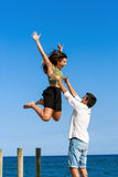 Young man catching girlfriend in air. Stock Photos