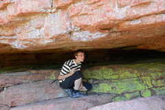 Young man in a cave Stock Photography