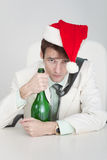 Young man celebrates Christmas at office Royalty Free Stock Photos