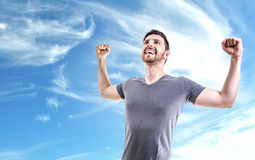 Young man celebrating on a beautiful day Stock Photos