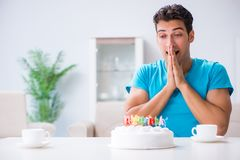 The young man celebrating birthday alone at home stock photos