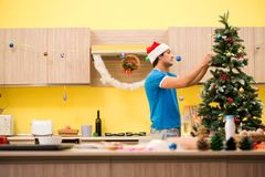 The young man celebrating christmas in kitchen stock image