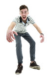 Young man celebrating his success over white background Royalty Free Stock Images