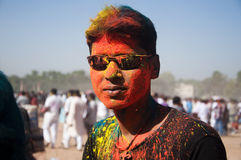 Young man celebrating holi festival. In India Stock Photography