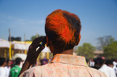 Young man celebrating holi festival. In India Royalty Free Stock Photography