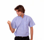Young man celebrating with positive attitude Royalty Free Stock Image