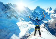 Young man celebrating reaching the top of a mountain. Extreme sp royalty free stock images