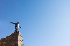 Young man celebrating on a ruined building Royalty Free Stock Image