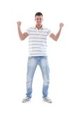Young man celebrating success smiling Royalty Free Stock Photography
