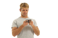 Young man on cell phone Stock Images