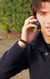 Young man with cell phone Royalty Free Stock Image